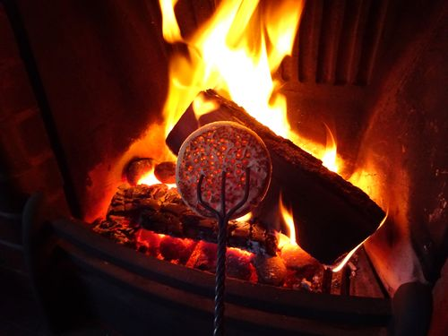 Image result for log fire and crumpets